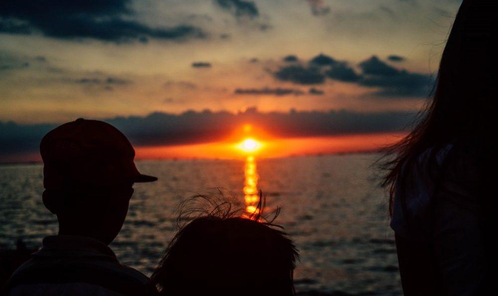 People Facing Sunset